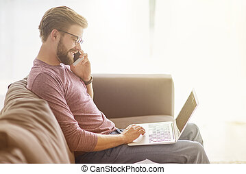 Young man is busy his work at home
