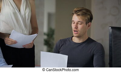 Young man is offering business decision to female boss...