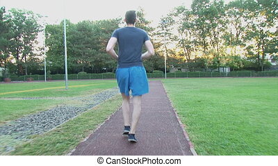 Young man jogging at sunrise