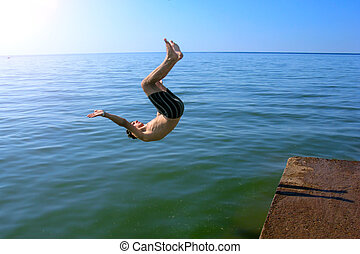 Young Man Jumping in The Sea