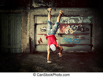 Young man jumping on grunge wall