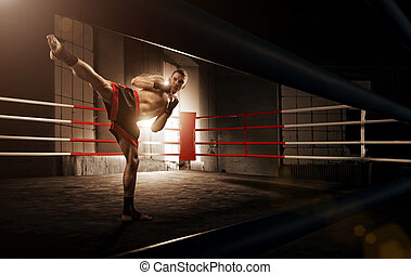 Young man kickboxing in the Arena - Young man kickboxing in...