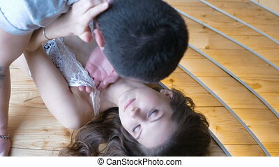 Young man kisses a girl. Close-up. Participate in a photo shoot.