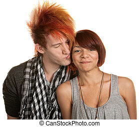 Young Man Kissing Girlfriend - Young man with mohawk kisses...