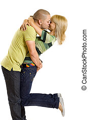 young man kissing his girlfriend in the air