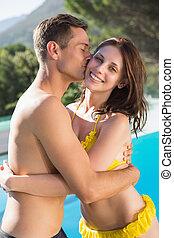 Young man kissing woman