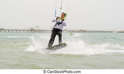 Young Man Kitesurfing in Ocean, Extreme summer sport hd,...