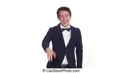 Young man laughing and pointing with a finger