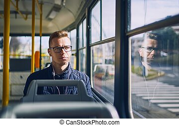 Travel by public transportation - Young man listening music ...