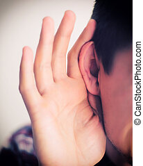 young man listening