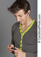 Young man listens to music
