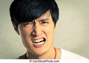 Young man looking angry and yelling, with fashion tone and...