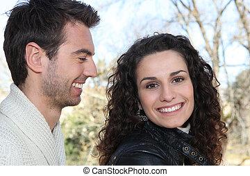 young man looking at girlfriend