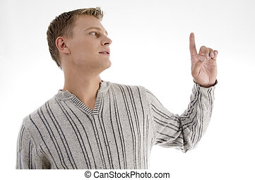 young man looking at his finger with white background