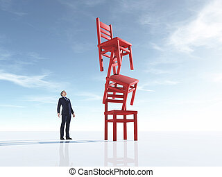 Young man looking at three chairs in equilibrium