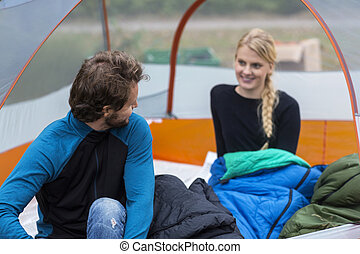 Young Man Looking At Woman In Tent