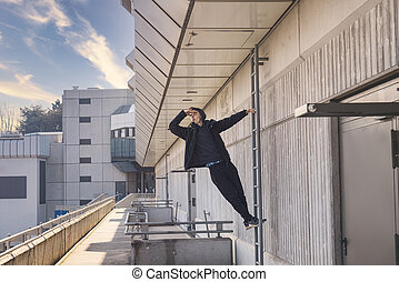 young man looking out on a ladder