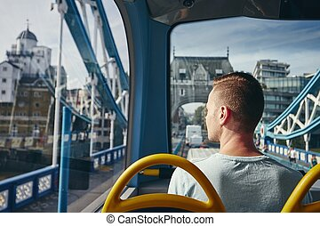 City life in London - Young man looking through window from ...
