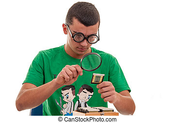 Young man looking with a magnifying glass at a photographic film of old times. Photo frame. Slide 35mm
