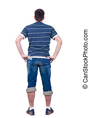 young man looks at white background. rear view.