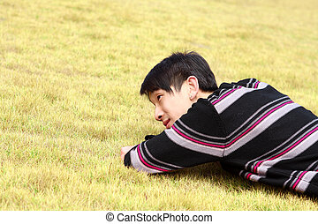 Young man lying on grass