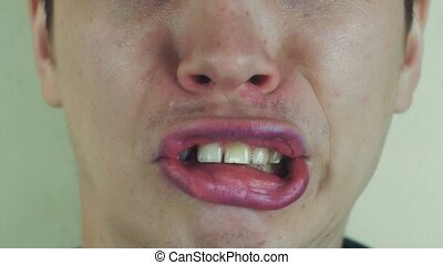 Young man make funny faces in front camera. Open mouth. Play...