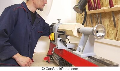 Young man makes woodworking of joinery in carpentry...