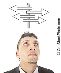 Young man making a choice with arrows isolated on white background