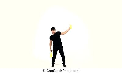 young man making cocktails with a yellow shaker