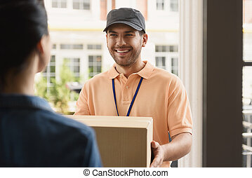 Young man making home delivery - Handling your packages with...
