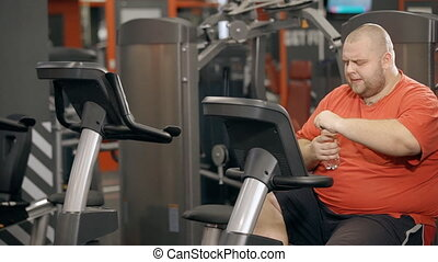 Young man making interval cycling for weightloss - Good-...