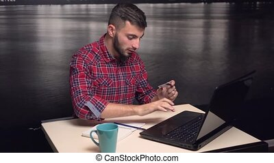 Young Man Making Online Payment with Credit Card
