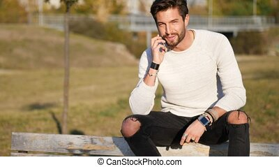 Young man making phone call outdoor in city