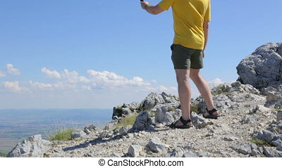 Young man making selfie on mountain
