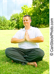 Young Man Meditate Outdoor