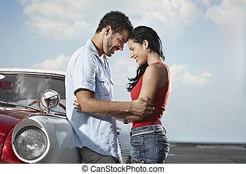 young man meeting beautiful woman and hugging