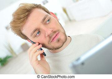 Young man multi tasking