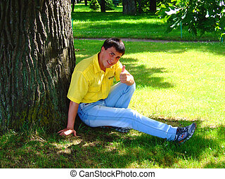 Young man near to a tree