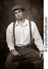 Young man in old fashioned outfit, suspenders from the early 1900