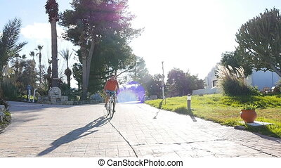 Young Man on a bicycle in the city at sunset in summer - Man...