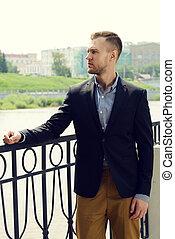 young man on a bridge