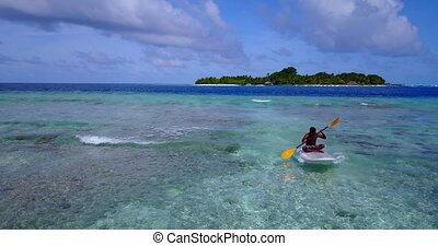 young man on a surfboard paddleboard with aerial flying...