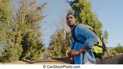 Young man on a trek with a rucksack