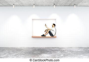 Young man on built-in-wall seating