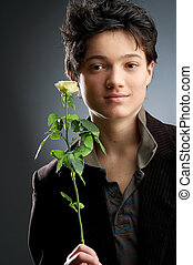 rose - young man on dark Background with yellow roses