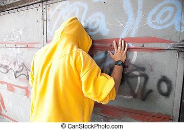 Young man on graffiti grunge wall