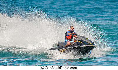 Young Man on Jet Ski, Tropical Ocean, Vacation Concept