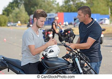 young man on motorcycle training course