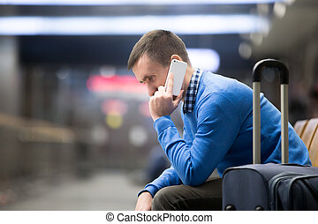 Young man on phone at airport