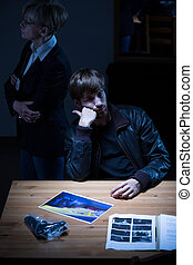 Young man on police station